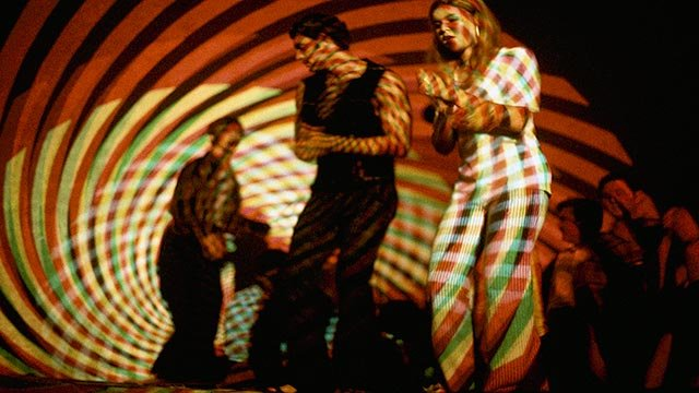 "A young couple dances a as psychedelic light show is projected on them at ""The Electric Circus"" nightclub on St. Marks Place in the East Village section of New York, Nov. 13, 1967. (Credit: AP Photo)"