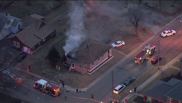 Metro East fire crews are calling the origin of the house fire suspicious. (Credit: KMOV)