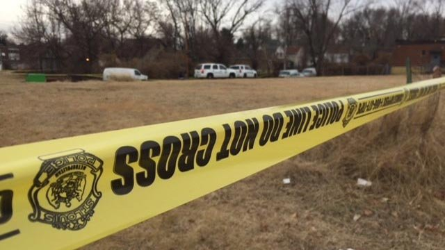 Investigators  in the 5000 block of Geraldine after a burned body was found (Credit: KMOV)