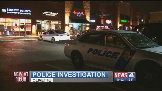 Investigators process the scene of an armed robbery at HoneyBaked Ham in Olivette (Credit:KMOV)