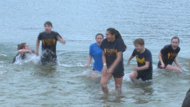 More than 350 people participated in Saturday's Polar Plunge in Lake St. Louis. (Credit: KMOV)