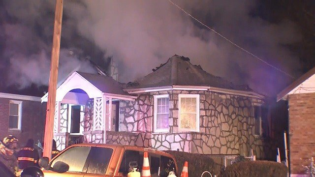 Crews work to combat a fire at a home near Natural Bridge Monday morning. (Credit: KMOV)
