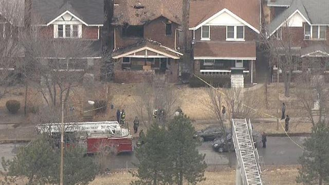 Firefighters at a home in the 4300 block of Lafayette Tuesday (Credit: KMOV)
