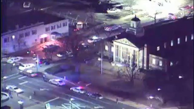 Police surround Kirkwood City Hall after a gunman opened fire inside in Feb. 7, 2008 (Credit: KMOV)
