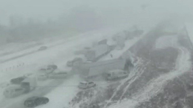 A 70-vehicle crash in Iowa is caught on Department of Transportation video. (Iowa DOT/CNN)