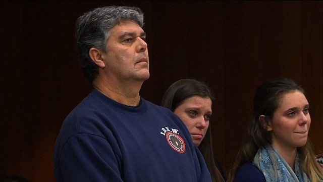Randall Margraves, the father of three daughters who have been abused by Larry Nassar tried to attack the former doctor in Eaton County court Friday before he was tackled and arrested by security. (Credit: CNN)