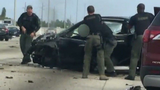 Cell phone video captured the Florida shooting of a wanted homicide suspect (Credit: WPLG / CNN)