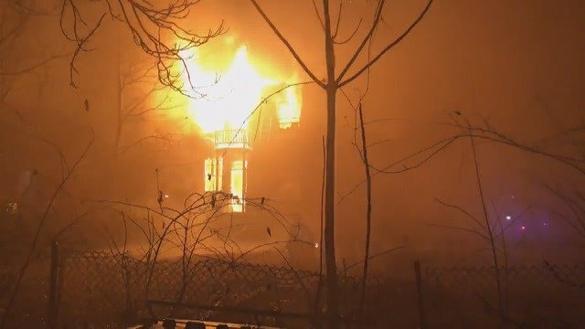 Firefighters battle a fire in a vacant home in North St. Louis Friday night. (Credit: KMOV)
