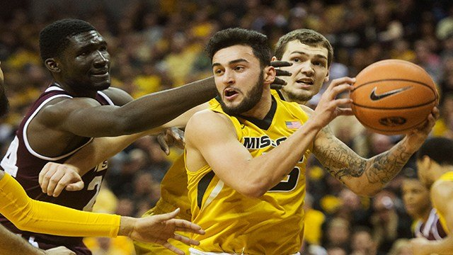 Missouri's Jordan Geist, center, pulls down a rebound in front of Mississippi State's Abdul Ado, left, as teammate Reed Nikko, right, looks on during the first half of an NCAA college basketball game Saturday in Columbia, Mo. (AP Photo/L.G Patterson)