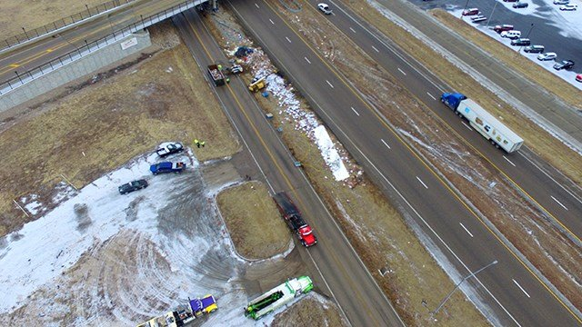 Drone view of clean-up crews removing crash debris from the scene in Sullivan (Credit: Will Sites)