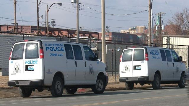 Police vehicles after a child was found after a carjacking in south St. Louis (Credit: KMOV)