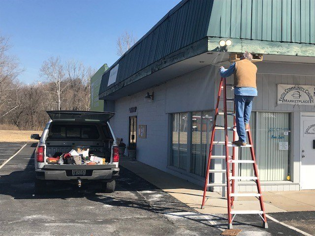 Peace by Piece Clothes Closet is in House Springs on the property of Faith Community Church. On Tuesday a worker installed motion sensor lights to help a surveillance camera record better video of thieves return to steal donated clothes.