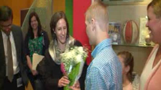 Brendan Woods giving flowers to Lesley Alexander (Credit: KMOV)