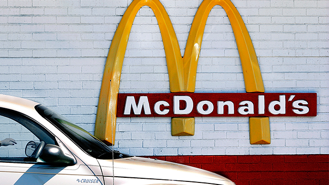 A customer moves through the drive up lane to place their order at a McDonald's restaurant  (AP Photo/Seth Perlman)