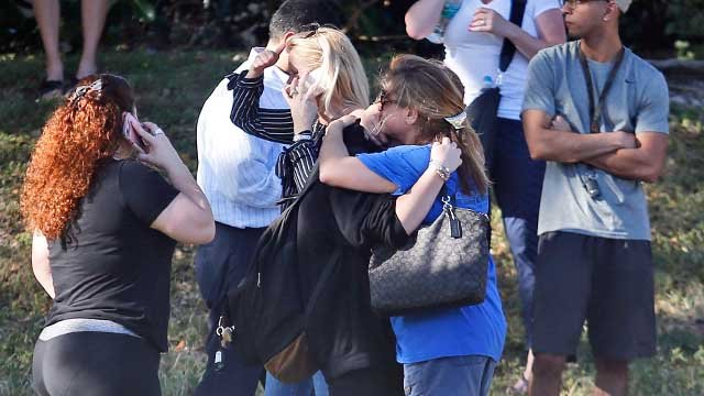 Outside of Marjory Stoneman Douglas High School in Parkland, Fla., on Wednesday, Feb. 14, 2018. (Credit: AP)
