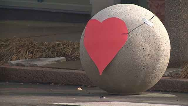 The controversial traffic balls in the Tower Grove East neighborhood are now getting love with hearts being placed on these structures for decoration.  (Credit: KMOV)