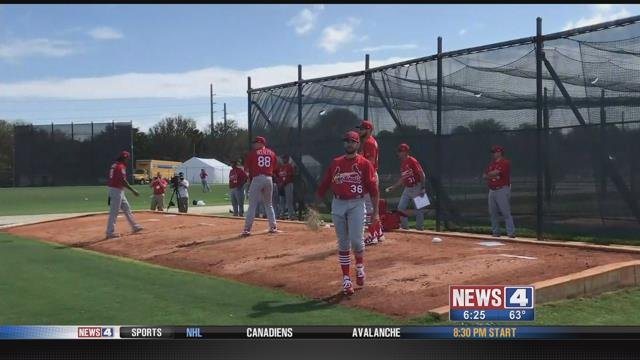 Cardinals pitchers throw during the first day of workouts for pitchers and catchers at Spring Traini