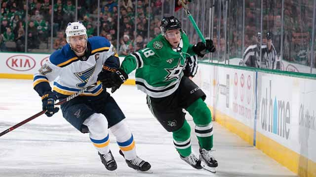 Tyler Pitlick #18 of the Dallas Stars battles for position against Alex Pietrangelo #27 of the St. Louis Blues at the American Airlines Center on February 16, 2018 in Dallas, Texas. (Photo by Glenn James/NHLI via Getty Images)