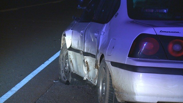 The New Athens officer's car was sideswiped by a van and was damaged on the driver's side. (Credit: KMOV)