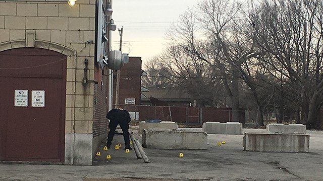 Investigators process the scene where a 9-year-old was shot Sunday ( Credit: KMOV )