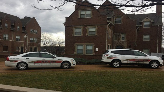 Police cars sit outside the Phi Delta Theta house Feb. 20. ( Credit: Danielle Drake Flam/Student Life)