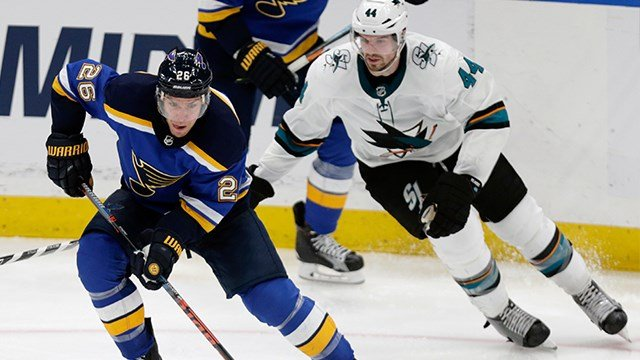 St. Louis Blues' Paul Stastny (26) controls the puck in front of San Jose Sharks' Marc-Edouard Vlasic (44) during the third period of an NHL hockey game Tuesday, Feb. 20, 2018, in St. Louis. The Sharks beat the Blues 3-2. (AP Photo/Tom Gannam)