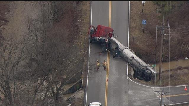 An overturned semi carrying paint on Old Highway M in Jefferson County. (KMOV)