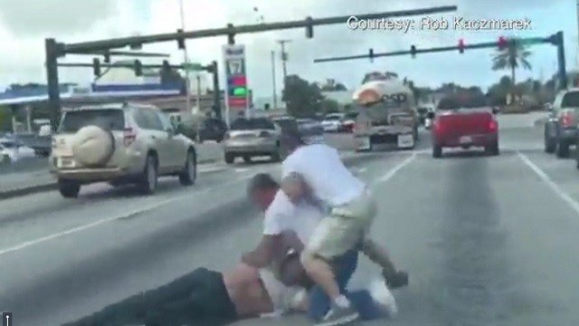 Video shows a road rage incident spilling onto a street in Florida. (WPTV/CNN)