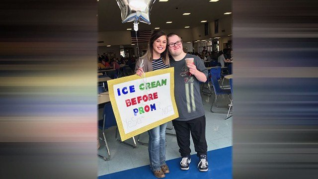 Gracie Schwents, left, asks friend with Down Syndrome, Jacob Brooks, right, to prom (Credit: KMOV)
