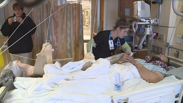 A nurse waits on John Nelson in his hospital room. (Credit: KMOV)