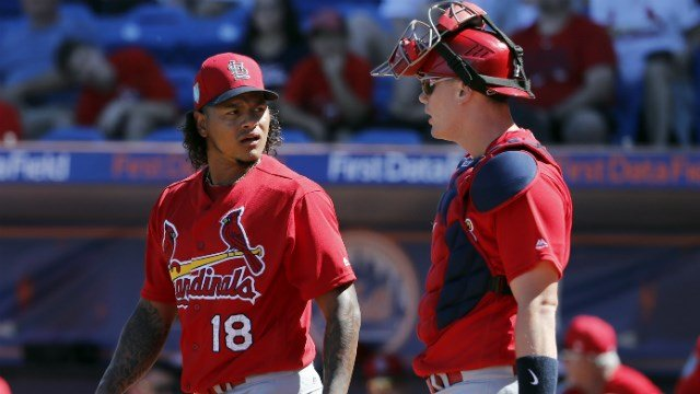 St. Louis Cardinals pitcher Carlos Martinez (18) walks back to the mound with catcher Carson Kelly during the first inning of an exhibition spring training baseball game against the New York Mets (AP Images)