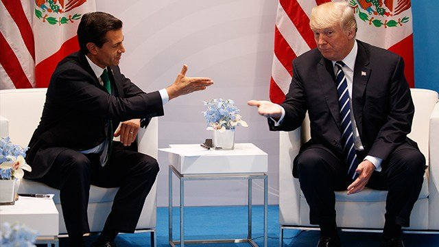 U.S. President Donald Trump meets with Mexican President Enrique Pena Nieto at the G20 Summit, in Hamburg July 2017. (AP Photo/Evan Vucci, File)
