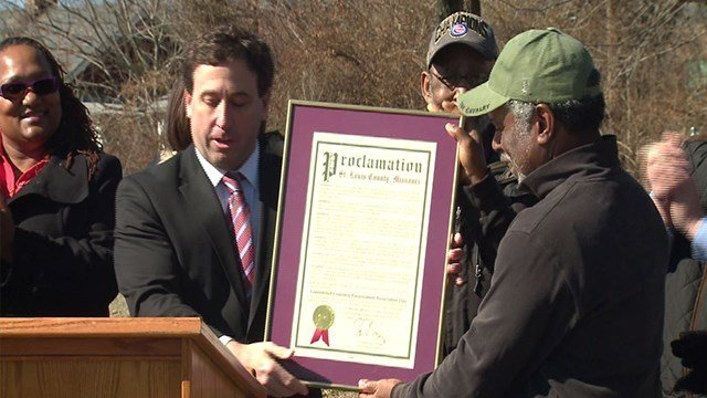 St. Louis County Executive Steve Stenger ,left, honored Raphael Morris,right, for his efforts to clean up Greenwood Cemetery (Credit: KMOV)