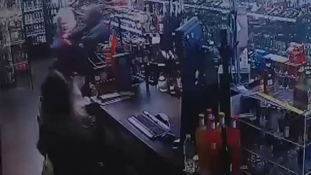 Surviellence images of a violent robbery attack in Tulsa, Okla. Thursday (Credit: Forest Arces Liquor)