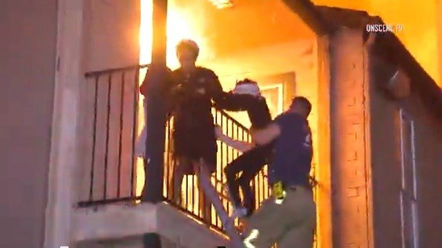 Firefighters in Houston, Texas rescued a mother and her children from their burning apartment just in time. (OnScene TV/CNN)