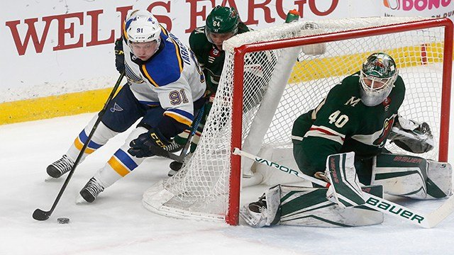 St. Louis Blues' Vladimir Tarasenko, left, of Russia,is pursued by Minnesota Wild's Mikael Granlund of Finland as goalie Devan Dubnyk protects the net in the second period of an NHL hockey game Tuesday, Feb. 27, 2018, in St. Paul, Minn. Tarasenko scored a