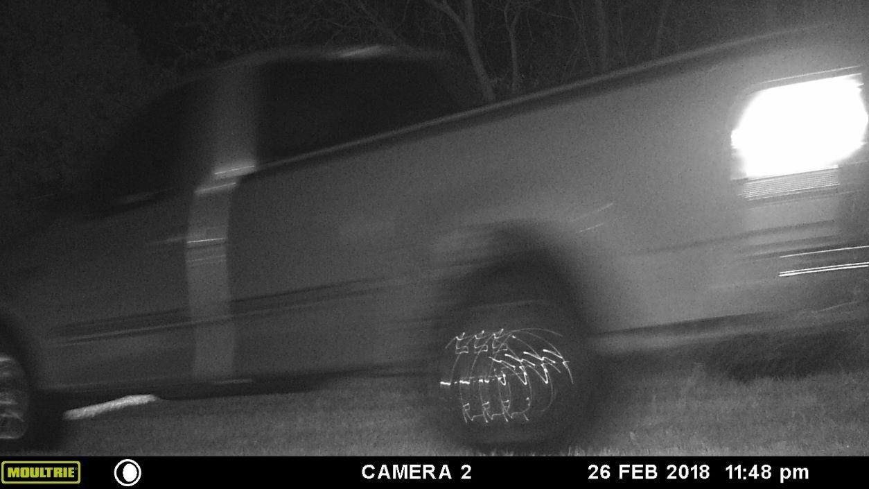 A trail camera captured images of the Ford F-150 driven by a vandal who drove across lawns in the Birch Creek Estates subdivision.