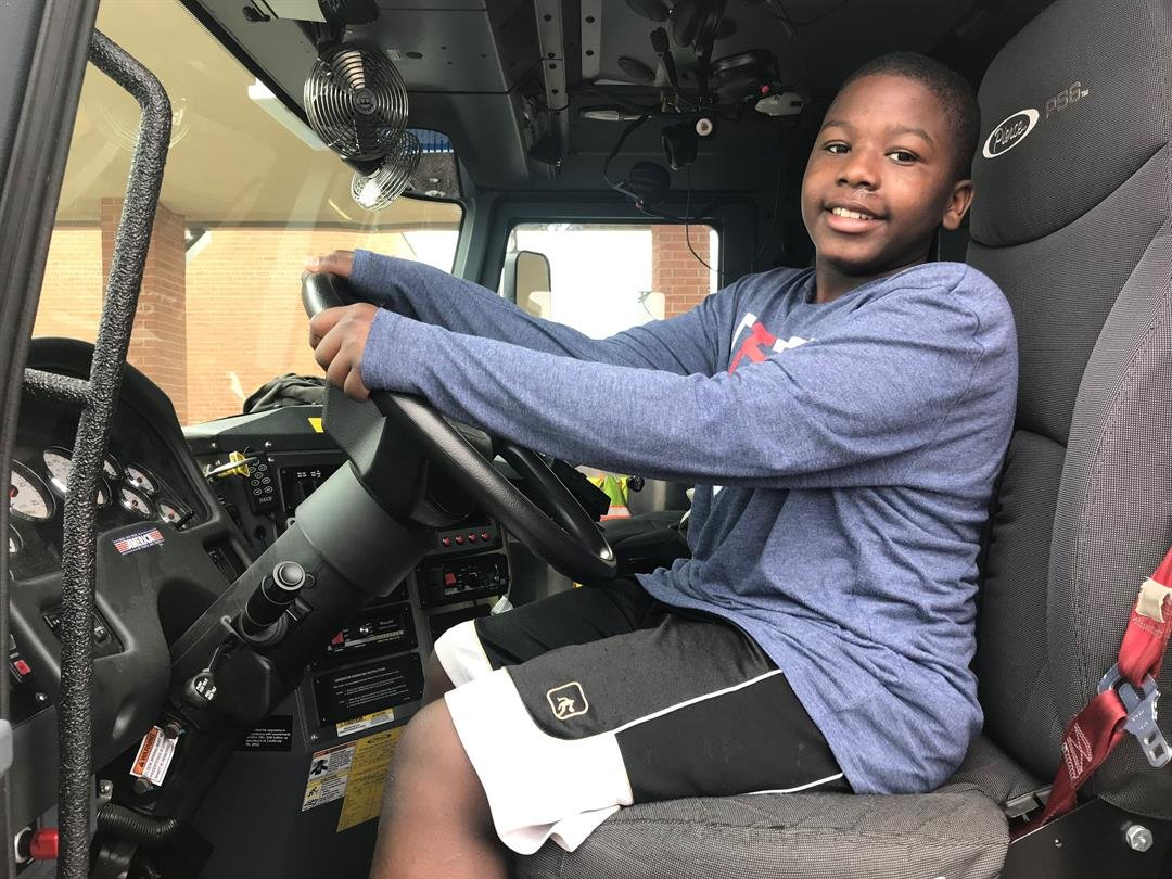 Ackerman School student, Jakhi Rainey got the change to get behind the wheel of a Florissant Valley Fire Protection District pumper truck during the school's Read Across America event.
