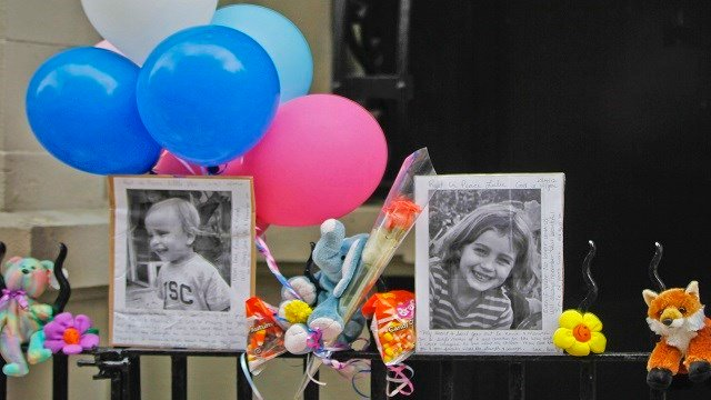 photographs of 6-year-old Lucia Krim and her 2-year-old brother, Leo, are displayed alongside balloons and stuffed animals at a memorial outside the apartment building where they lived in New York. Opening arguments begin Thursday, March 1, 2018, for Yose