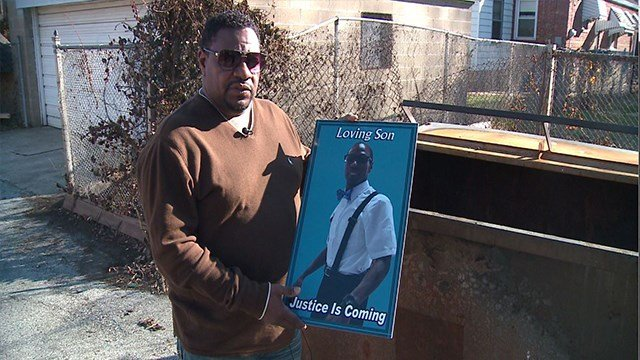 Ronnie Robinson holds a photo of his son Breyon, who was murdered and burned inside a dumpster ( Credit: KMOV)