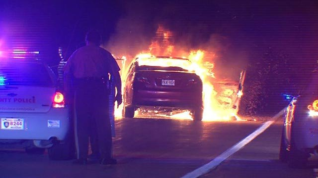 Two suspects were taken into custody after a car caught fire after a foot pursuit in North County (Credit: KMOV)