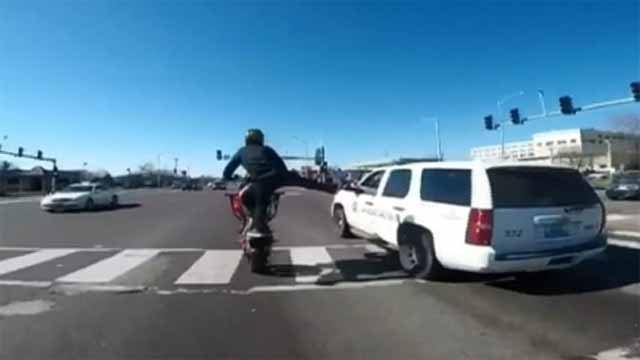 A video making its way around social media shows a stunt motorcycle rider driving down Natural Bridge near Kingshighway right next to a St. Louis Police officer. Credit: Mike Kulla