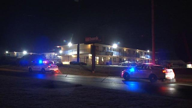 Police at the Budget Inn after a shooting victim was found (Credit: KMOV)