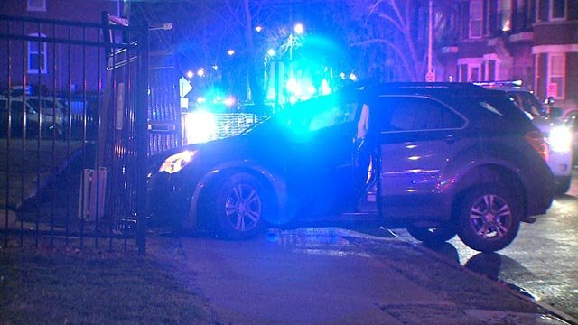 A stolen SUV crashed into a parked car and then a fence at West Pine & Boyle (Credit: KMOV)