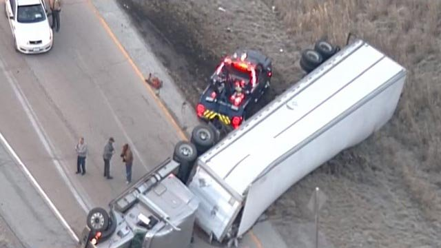 A tow truck on the scene after a semi-truck overturned Friday (Credit: KMOV)