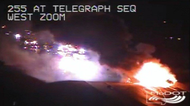 A semi truck overturned and caught fire on I-255 near Telegraph early Saturday morning. The interstate was closed for several hours. (Credit: MoDOT)