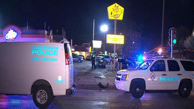 Emergency crews at the Church's Chicken on North Kingshighway after 2 women were hit by a car (Credit: KMOV)