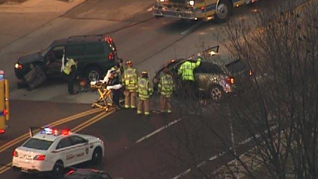 Emergency crews at Heege & Laclede Station Road after a crash Monday (Credit: KMOV))