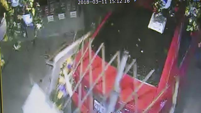 Surveillance video of a car crashing into 'The Fruit Stand' in Wood River (Credit: The Fruit Stand)