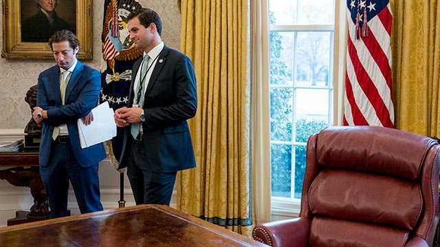 White House aide John McEntee, right, and Treasury Secretary Steve Mnuchin's Chief of Staff Eli Miller, left, stand in the Oval Office. (AP Photo/Andrew Harnik)